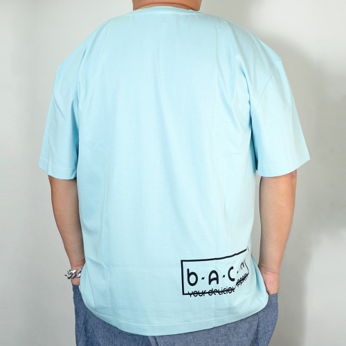 B. Badge Tee - Light Blue